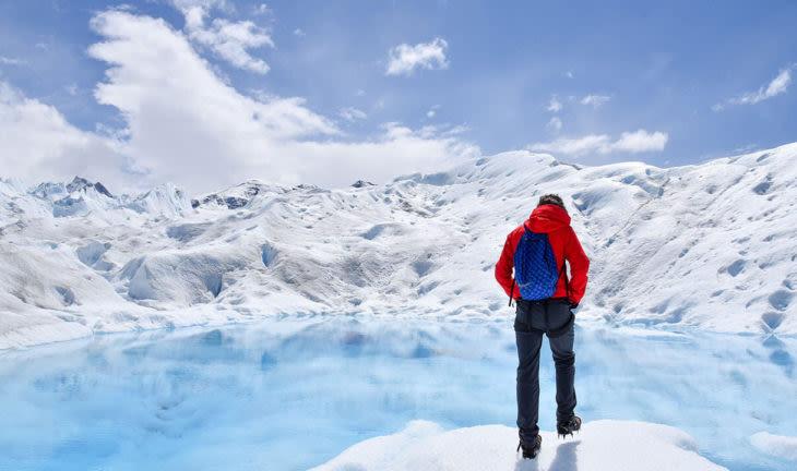 man exploring glacier