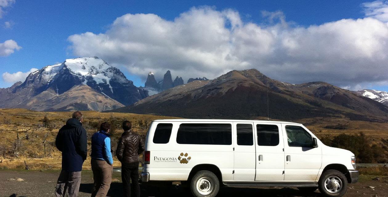hikers exploring by rental car in patagonia
